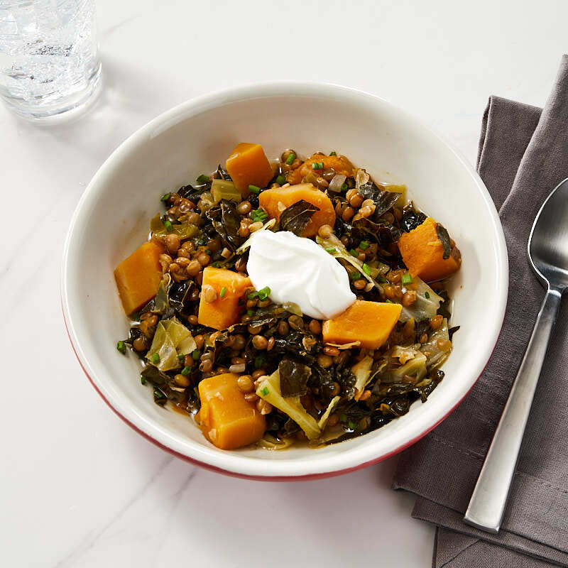 Photo of Butternut squash, greens, and lentil stew by Daphne Oz by WW