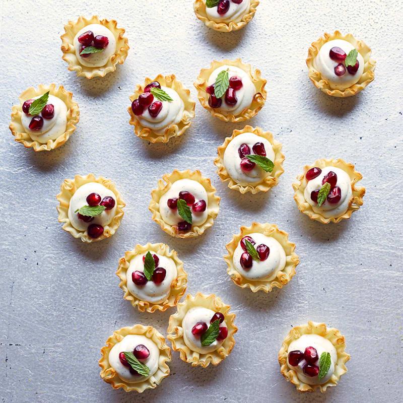 Photo of Mini vanilla bean-pomegranate cheesecake tarts by WW