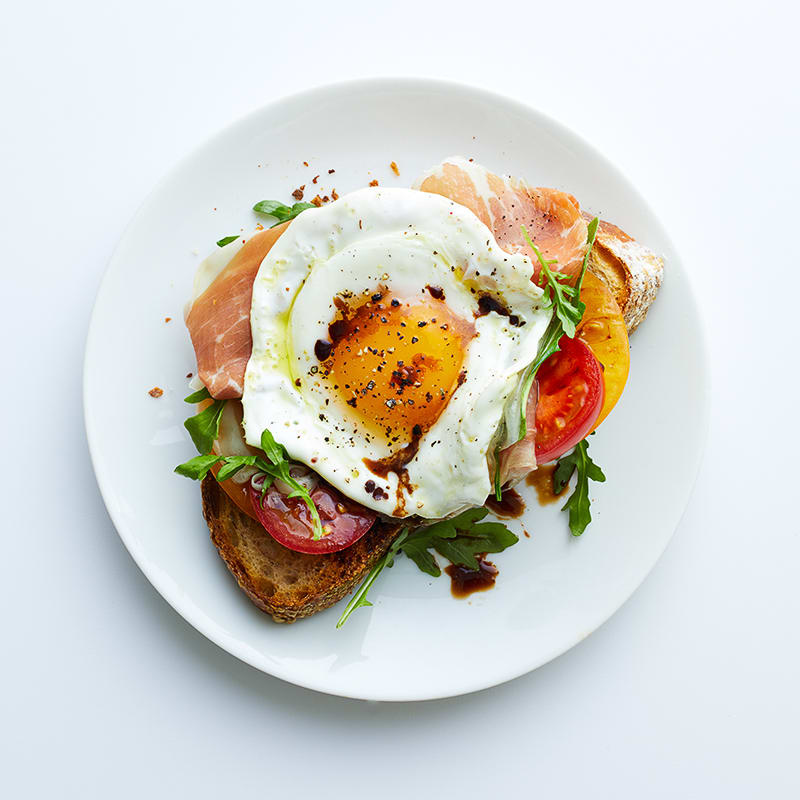 Photo of Fried egg, prosciutto and arugula breakfast toast by WW