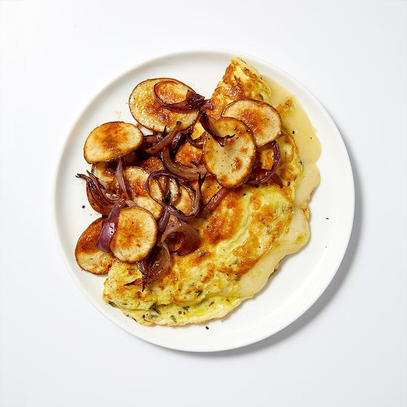 Photo of Roasted potatoes & onions with a Swiss cheese omelet by WW