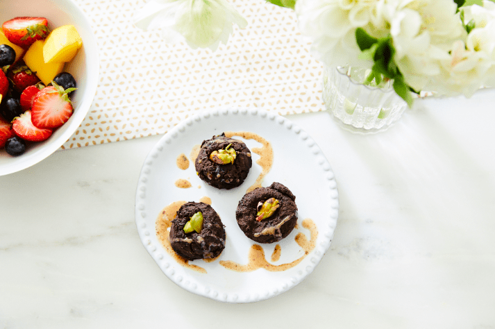 Photo of Cat Cora's toasted pistachio brownie bites by WW