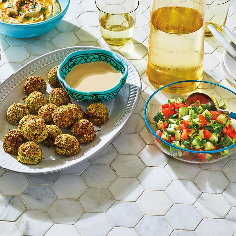 Photo of Air-fried falafel with tahini sauce & Israeli salad by WW