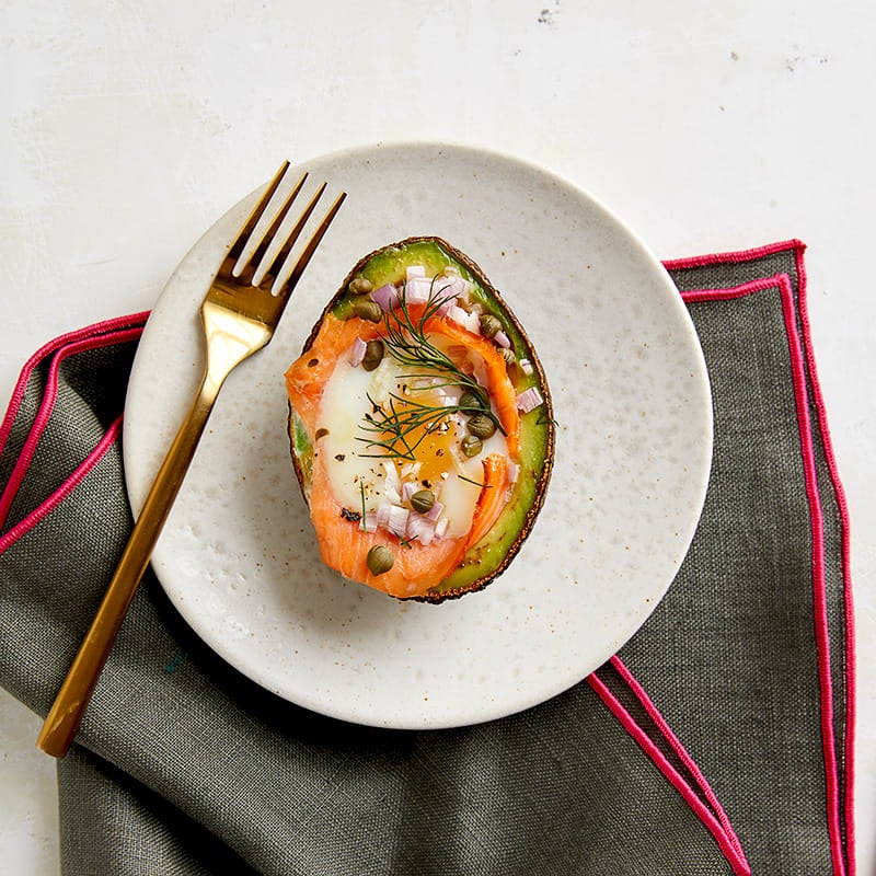 Photo of Egg baked in avocado with smoked salmon, capers & dill by WW