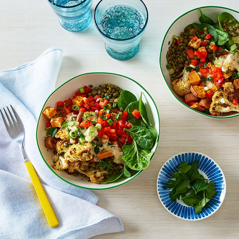 Photo of Lentil, sweet potato, and cauliflower bowl with tahini dressing by WW