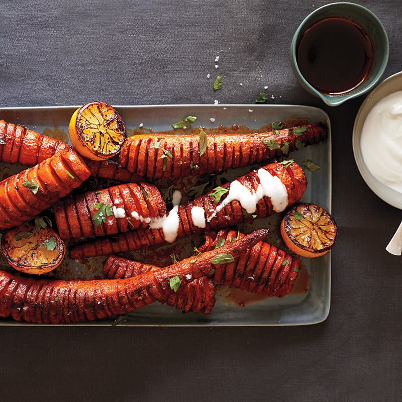 Photo of Hasselback carrots with smoked paprika,  roasted lemon, and yogurt sauce by WW