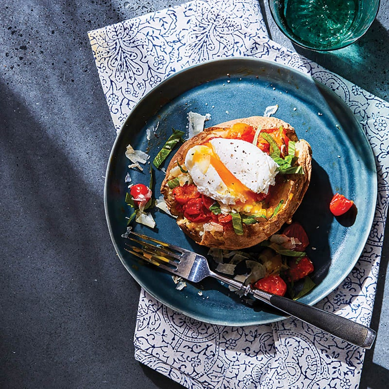 Photo of Baked potato with saucy tomatoes and poached egg by WW