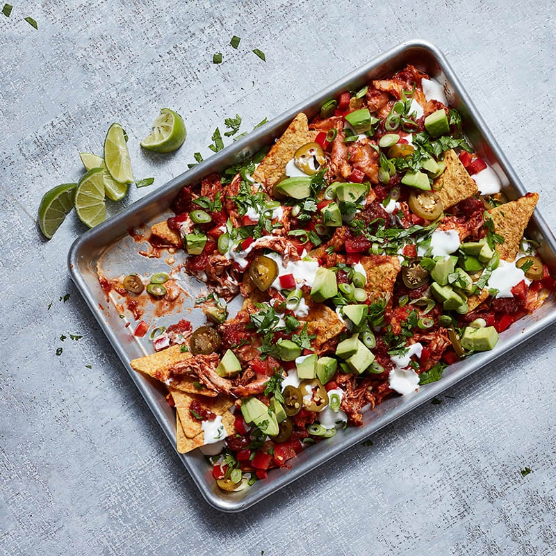 Photo of Chipotle pulled-chicken nachos with avocado and lime cream by WW