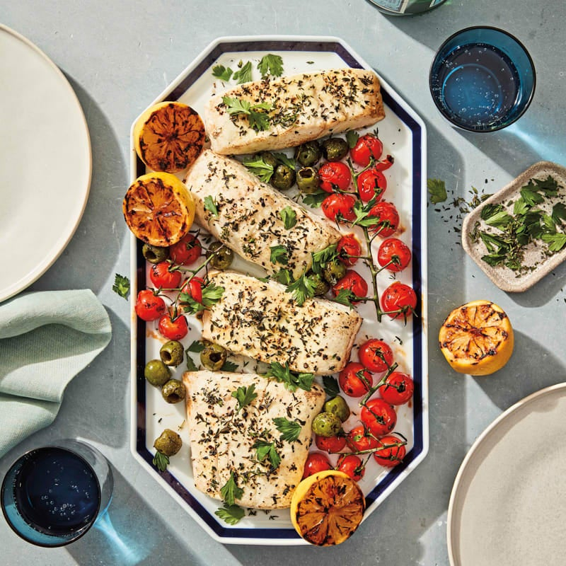 Photo of Grilled halibut with charred tomatoes, lemons, and olives by WW