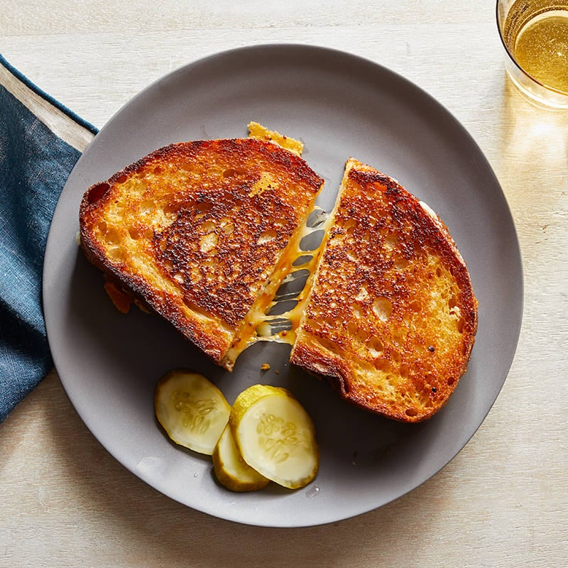Photo of Grilled cheddar cheese sandwiches with pickles by WW