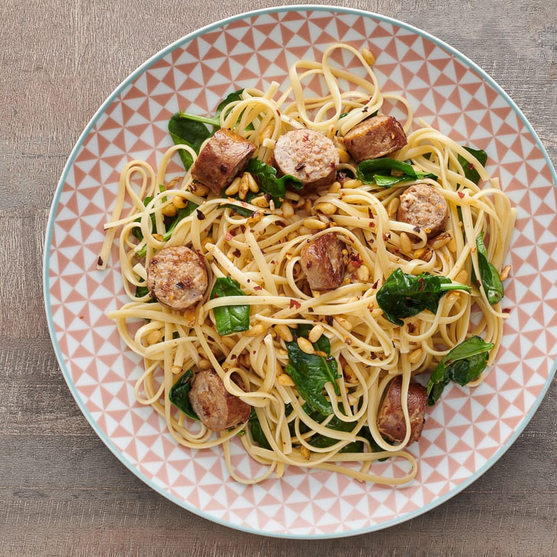 Photo of Pasta with sausage, spinach, and pine nuts by WW