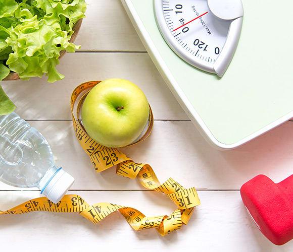 Indicatoren voor een gezond gewicht: meetlint en weegschaal