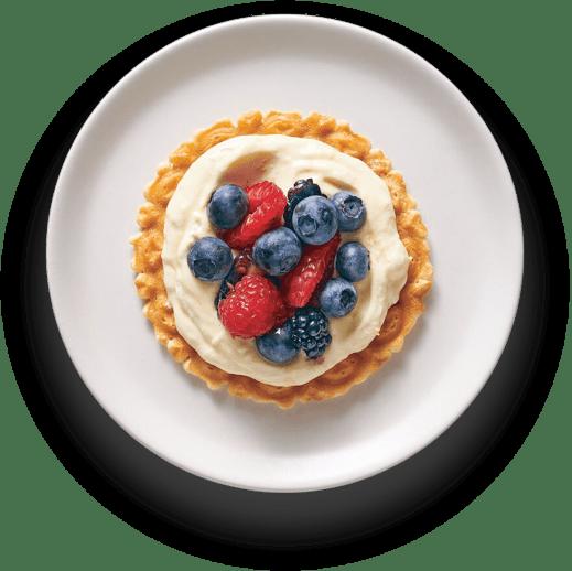 Lemon-berry pizzelle tart on a plate
