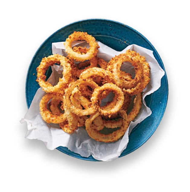 Crunchy onion rings with kefir ranch dip on a plate