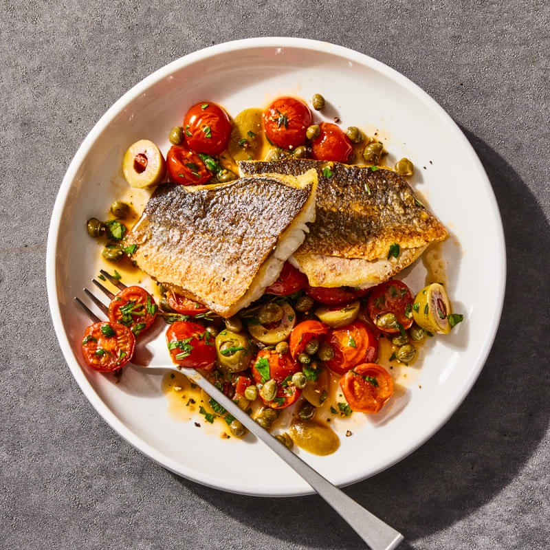 Photo of Pan-seared branzino with tomatoes, olives, and capers by Millie Peartree by WW