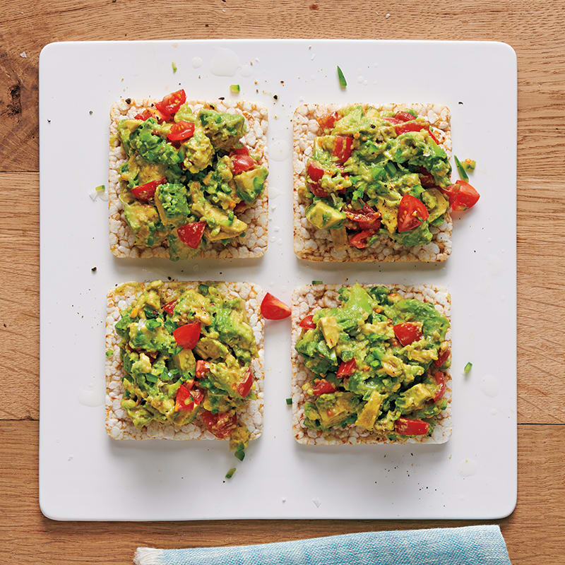 Photo of Chunky guacamole–topped rice cakes by WW