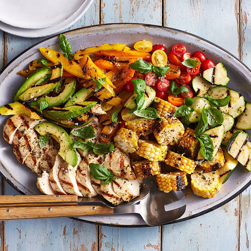 Photo of Grilled corn, chicken, and summer vegetable salad by WW