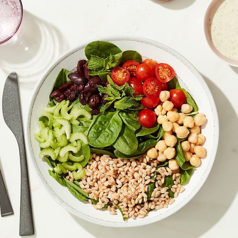Photo of Cat Cora's spinach, chickpea, and tahini bowl by WW