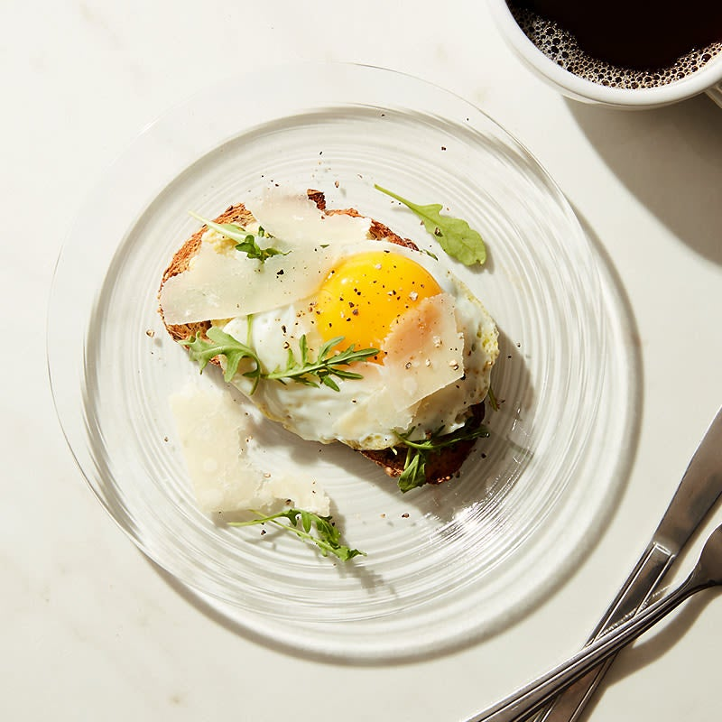 Photo of Cat Cora's artichoke spread on rye bread with an egg and shaved parmesan by WW
