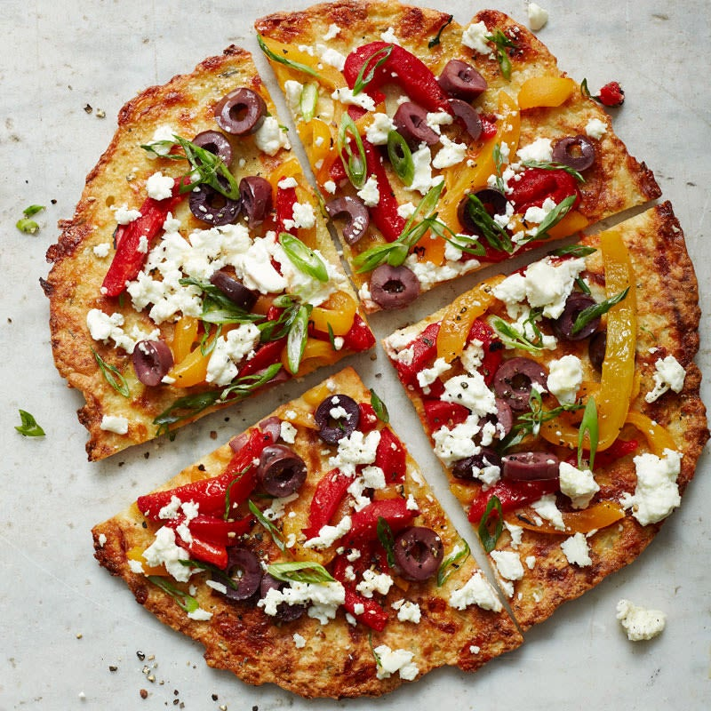 Photo of Cauliflower crust pizza with feta, peppers, and olives by WW