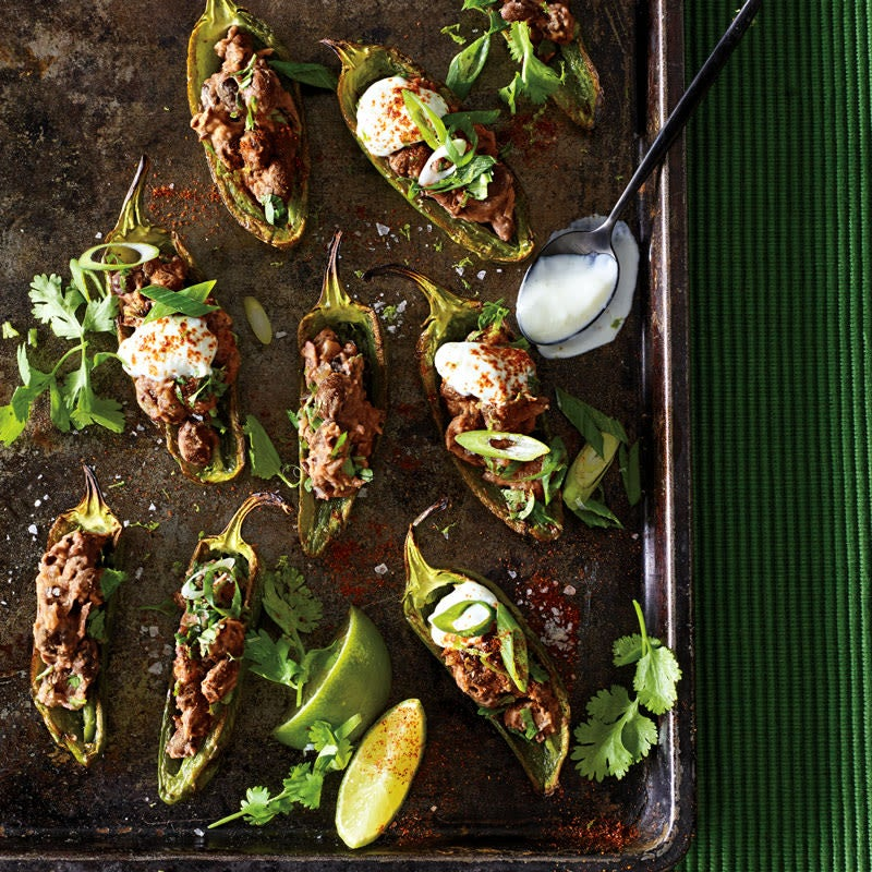 Photo of Broiled jalapeño poppers with black beans and lime cream by WW