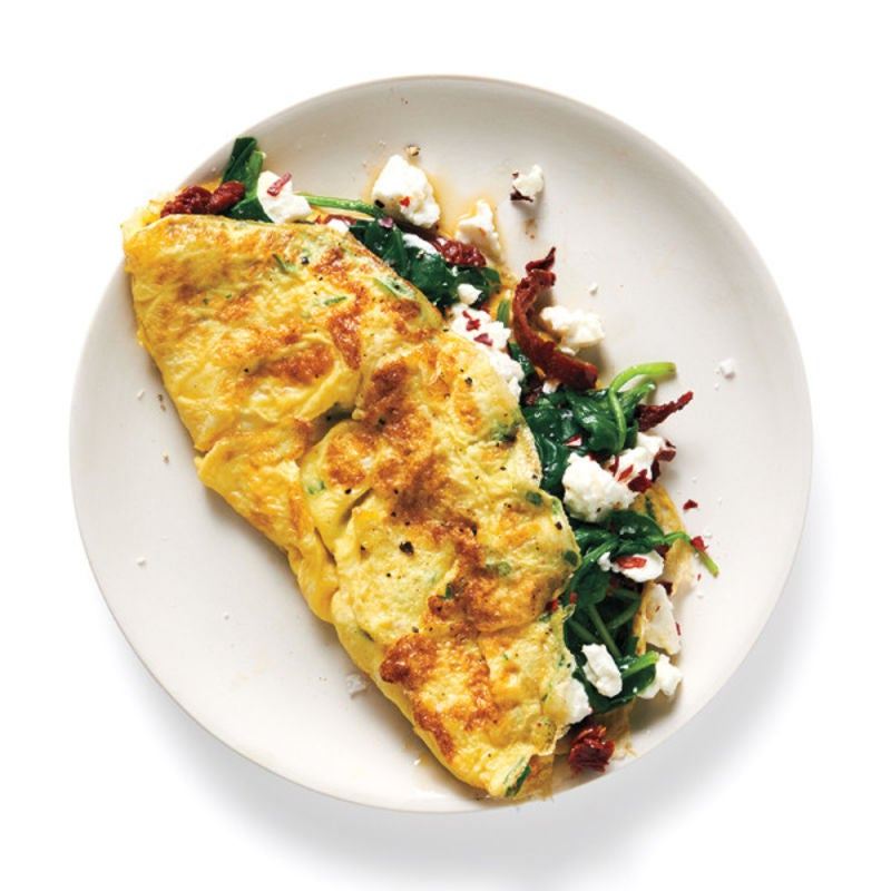 Photo of Spinach, sun-dried tomato, and feta omelette by WW