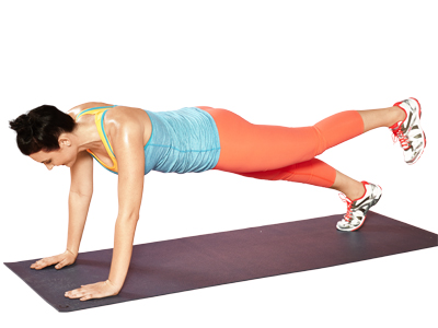 woman doing heel lift plank