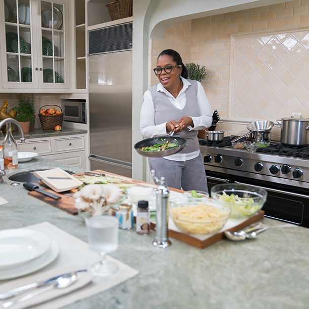 Oprah cooking in the kitchen