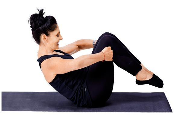 Pilates - Rolling like a ball pose