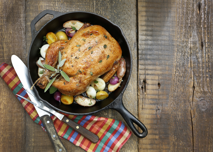 Baked chicken in a cast iron pan