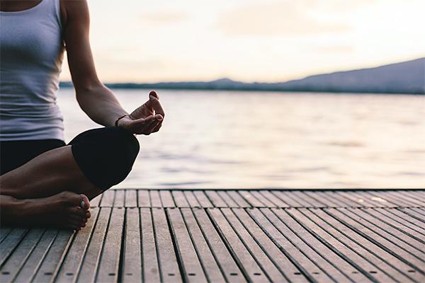 Meditating on pier