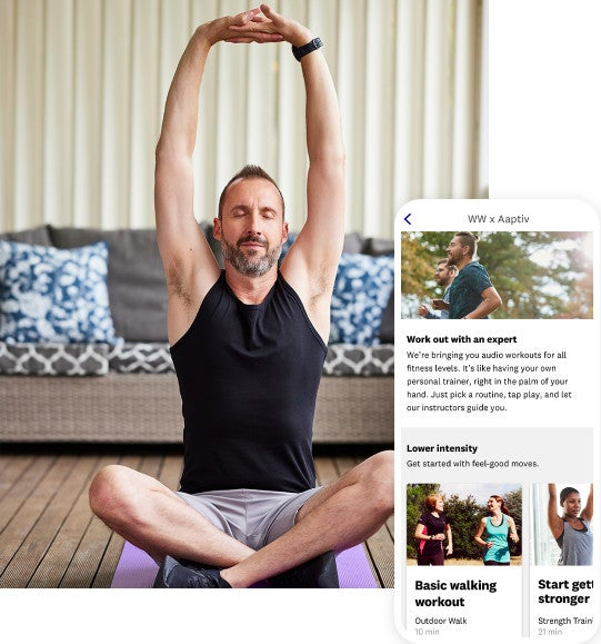 A man sits cross-legged on a yoga mat. His eyes are closed and his arms are raised above his head with his fingers interlaced in a yoga pose. Superimposed to the right is a mobile app screenshot of the Aaptive content page with various fitness program options.
