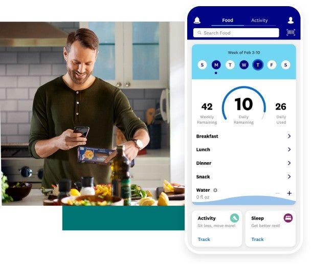 Man using the WW app to track his meal
